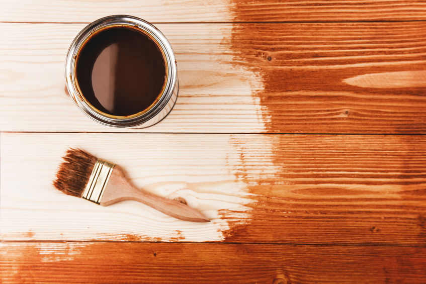 52725911 - varnishing a wooden shelf. paintbrush and can on the wooden surface