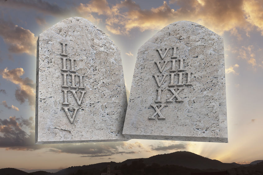 44507029 - the ten commandments on a sunset background