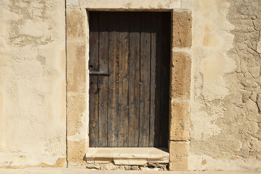 16442308 - wooden door in a mediterranean castle